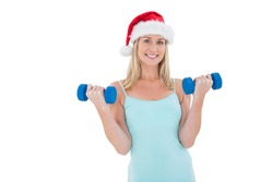 Festive fit blonde holding dumbbells on white background