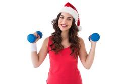 Festive fit brunette holding dumbbells on white background