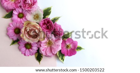 Festive floral arrangement of pink and crimson roses on a white background. Delicate pastels. Delicate style. Background for cards, invitations, greetings. #1500203522