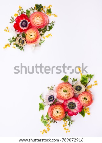 Festive flower composition made of fresh buttercups and anemone on the white background. Overhead view. #789072916