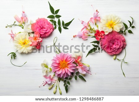 Festive flower composition on the white wooden background. Overhead view #1298486887