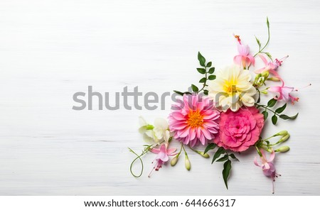 Festive flower composition on the white wooden background. Overhead view #644666317
