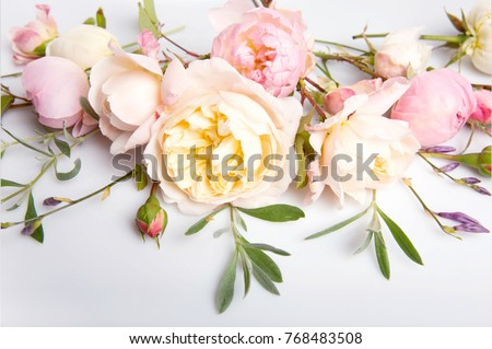 Festive flower English rose composition on the white background. Overhead top view, flat lay. Copy space. Birthday, Mother's, Valentines, Women's, Wedding Day concept.