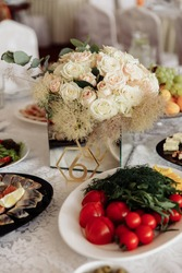 festive food lies on the wedding table. buffet for guests. a lavish banquet. wedding buffet. different cheeses. table for guests. wedding treat