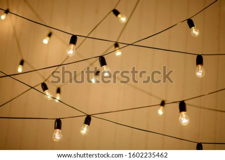 festive garland of electric retro lamps for a birthday party. Happy New Year and Merry Christmas.