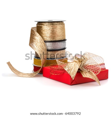 Festive gift box and wrapping ribbons isolated on white background