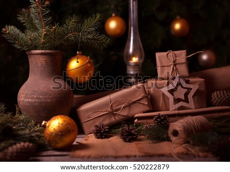 Festive Gifts with Boxes, Coniferous, Basket, Pine Cones on Wooden Background. Christmas Presents Toned in Vintage Style #520222879
