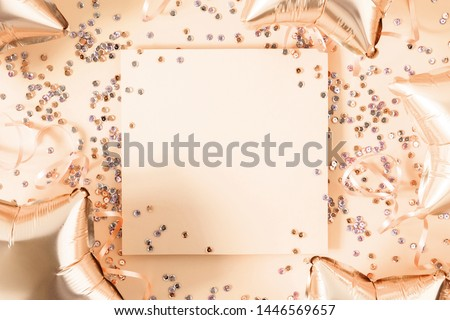 Festive gold  background. Empty paper blank, shining stars and shining balloons, confetti on gold background. Christmas. Wedding. Birthday. Flat lay, top view, copy spac #1446569657