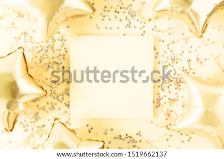 Festive gold Christmas composition. Empty paper blank, shining stars and shining balloons, confetti on gold background. Xmas. Wedding. Birthday. Flat lay, top view, copy space #1519662137