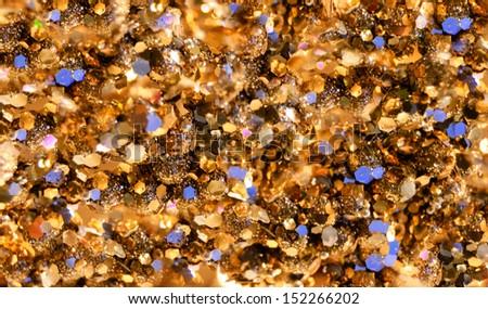 Festive golden sparkle background with violet spots.