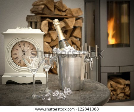 festive home interior with champagne, vintage clock and fireplace. selective focus