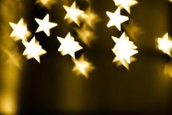 Festive overlay effect. Golden stars bokeh festive glitter background. Christmas, New Year and Valentine's day design