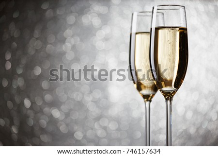 Festive picture of two wine glasses with sparkling champagne #746157634