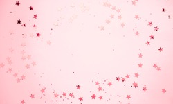 Festive pink background. Shining stars on light pink pastel background. Christmas. Wedding. Birthday. Happy woman's day. Mothers Day. Valentine's Day. Flat lay, top view, copy space.