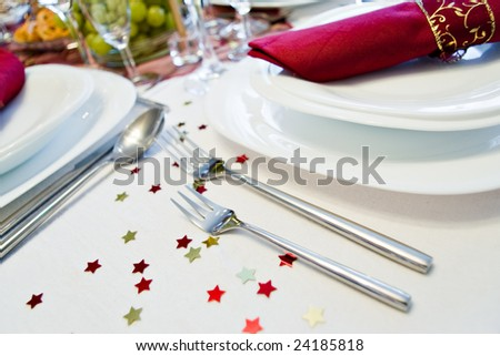 festive place setting with little stars and shallow depth of field