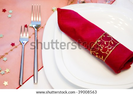 festive place setting with white plates and forks