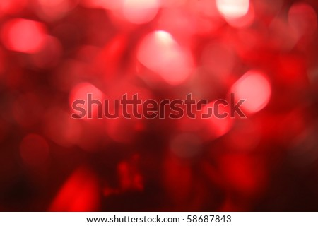 Festive red background bokeh of glare