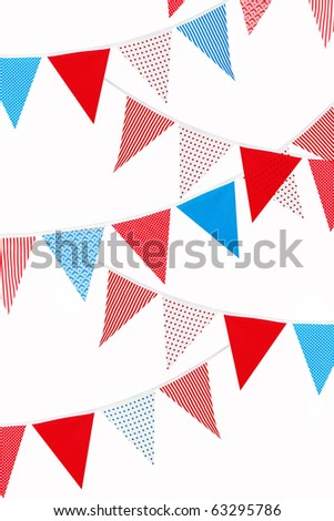 festive red, blue and white bunting flags on white background