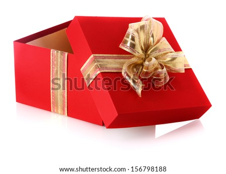 Festive red gift box with an open lid and golden bow for celebrating Christmas, Valentines, birthday or an anniversary on a reflective white surface