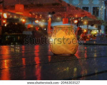 festive romantic wooden lantern candle light red rowan branch on the medieval wall of the house vintage cast-iron bars on the windows of the houses city clock blurry light streets Tallinn Old Town Aut Stock fotó ©
