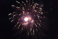 Festive salute in the night sky. Explosions of fireworks.