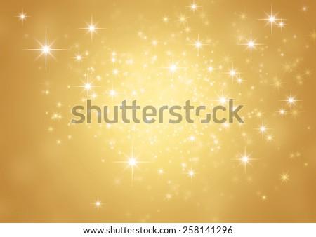 Festive sparkling lights. Shiny gold background in starlight