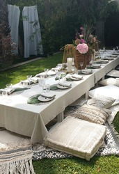 festive table decor dinner outdoor garden party wedding oriental cushions pampas grass palmtrees bohemian boho