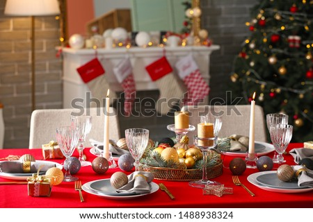 Festive table setting for Christmas dinner at home