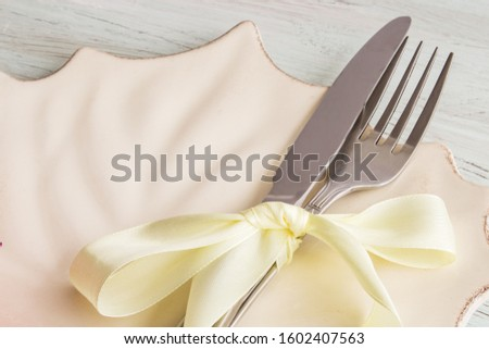 Festive table setting. Table setting in classic colors for the winter holidays. Holiday concept.