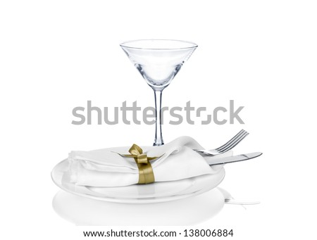 Festive table setting with blue bow isolated on white