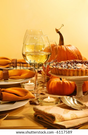 Festive table with candles and pumpkins ready for Thanksgiving