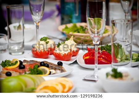 Festive well-laid table with food and drink