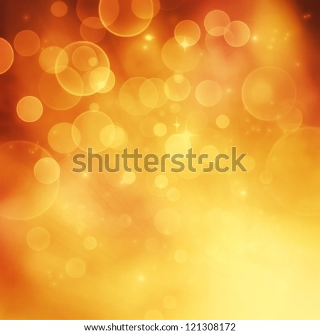 Festive winter  gold abstract. background with  bokeh lights and stars