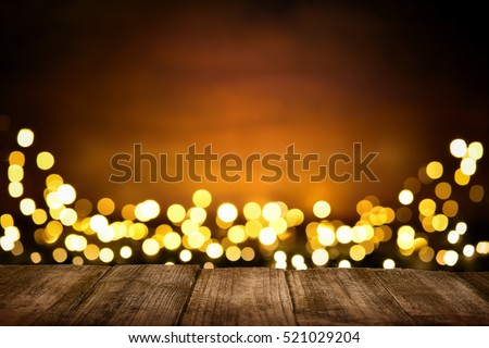 Festive wooden background with glittering bokeh lights, illuminated by a spotlight, ideal for Christmas or other occasions #521029204