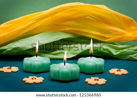 festive yellow-green background with candles and flowers