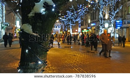 festivities at the night bright city with brightly decoration #787838596