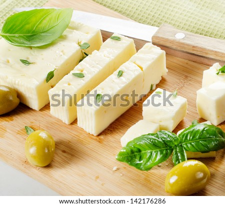 Feta cheese and  green olives .Selective focus