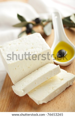 Feta cheese with black olives in olive oil