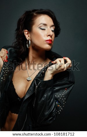 Fetish Model In Sexy Outfit In Leather Rock Jacket Stock Photo