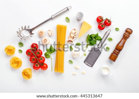 Fettuccine and spaghetti with ingredients for cooking pasta on a white background, top view. Flat lay