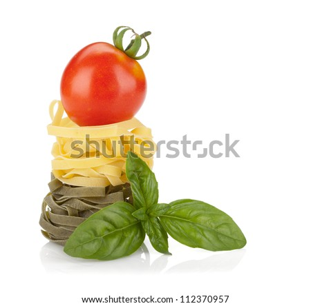 Fettuccine nest pasta with tomato cherry on top. Isolated on white background