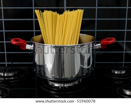 Fettuccine pasta in a cooking pot ready for cooking
