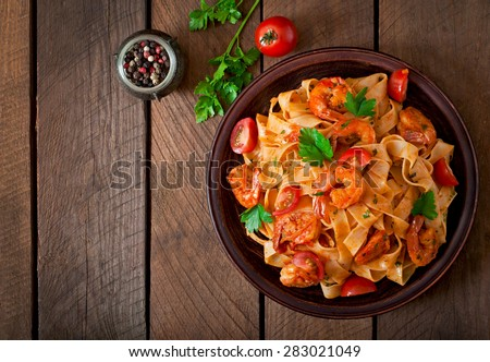 Fettuccine pasta with shrimp, tomatoes and herbs. Top view #283021049