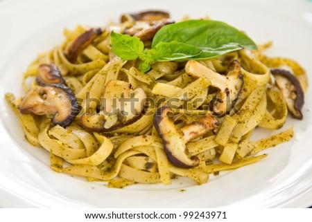 Fettuccine with mushroom in pesto sauce