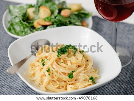 Fettuccini Alfredo with Ceasar Salad and wine