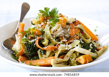 Fettucine primavera, topped with shaved parmesan.  Delicious spring vegetables.