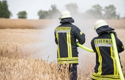 Feuerwehr, Fire department, extinguish a burning cereal field, Germany
