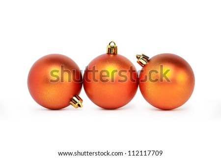 Few Christmas balls lying on white background in a row. Clipping path is included