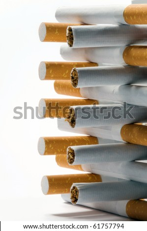 few cigarettes lying on a white background