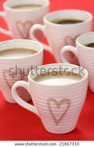 few cups of coffee on red background - food and drink